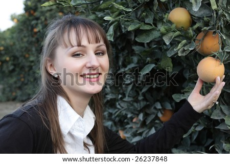 Portrait of smiling girl in a orchard - stock photo