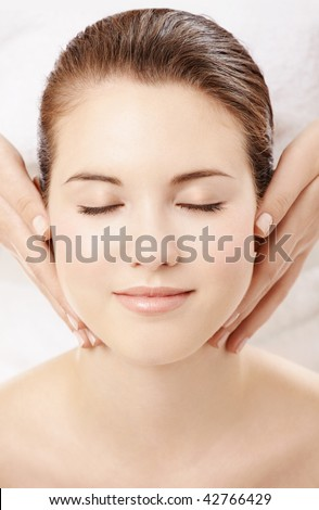Portrait of smiling girl, in the course of cosmetology procedure, isolated - stock photo