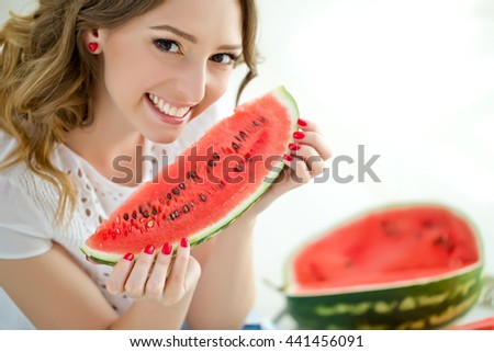 Portrait of smiling girl with watermelon