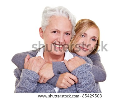 Portrait of smiling grandmother and her granddaughter - stock photo
