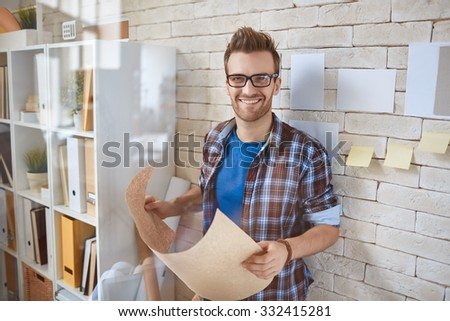 Portrait of smiling gut with paperwork - stock photo