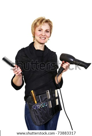 Portrait of smiling hairdresser with her work tools - stock photo