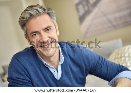 Portrait of smiling handsome man with grey hair  - stock photo