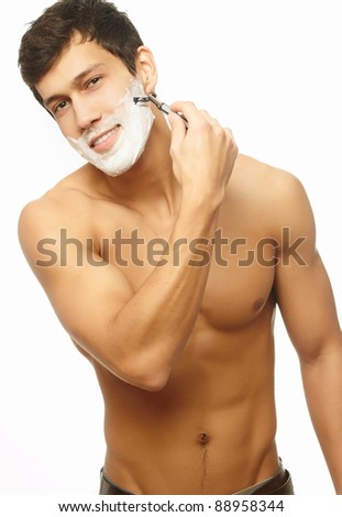 Portrait of smiling handsome successful shaving man  isolated on white background - stock photo