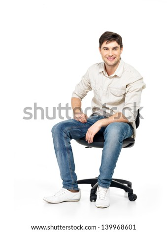 Portrait of smiling happy man sits on the office chair isolated on white. - stock photo