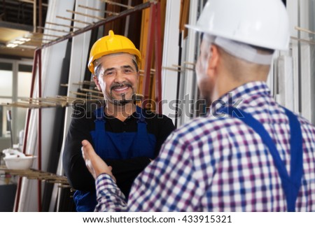 Portrait of smiling happy worker at PVC windows factory