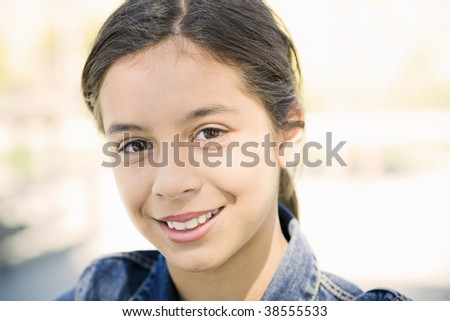 Portrait of Smiling Hispanic Teen Girl Looking To Camera - stock photo