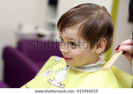 Portrait of smiling kid at the barbershop - stock photo
