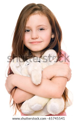 Portrait of smiling little girl with a teddy elephant. Isolated - stock photo