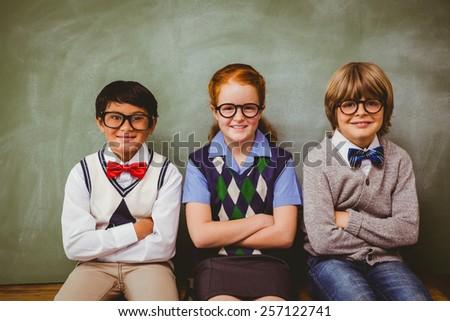 Portrait of smiling little school kids in classroom - stock photo