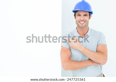 Portrait of smiling male architect with bill board over white background - stock photo