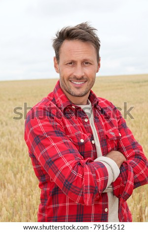 Portrait of smiling man in countryside - stock photo