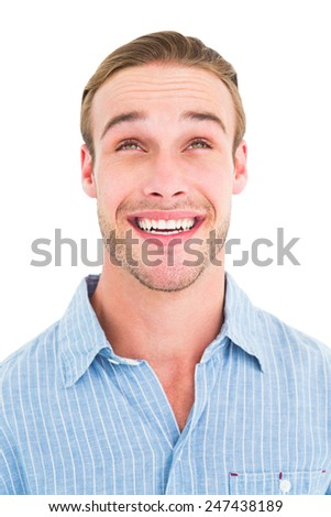 Portrait of smiling man in shirt looking upwards