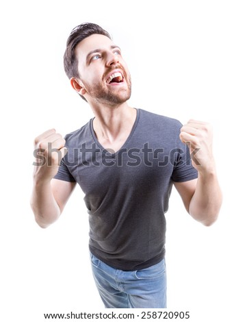 Portrait of smiling man with the fists up against a white background - stock photo