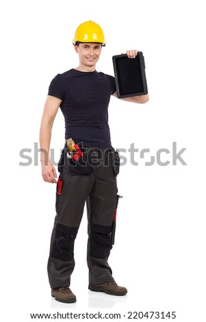 Portrait of smiling manual worker holding a digital tablet. Full length studio shot isolated on white.