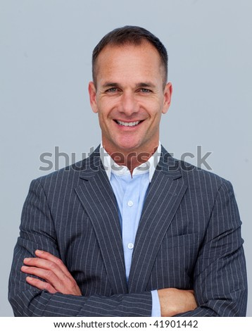 Portrait of smiling mature businessman with folded arms - stock photo