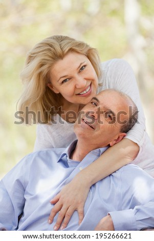 Portrait of smiling mature family at countryside in summer day