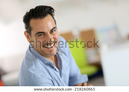 Portrait of smiling mature man - stock photo