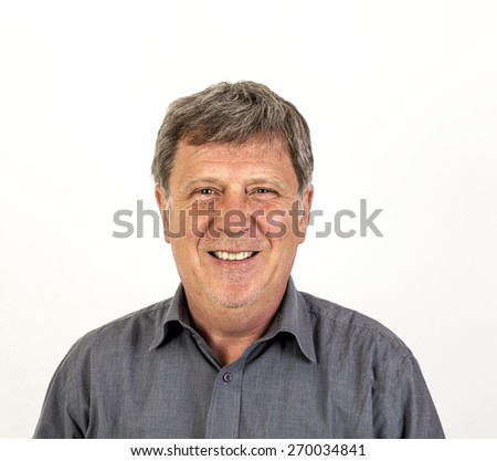 portrait of smiling mature man with grey polo shirt - stock photo