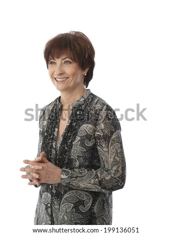 Portrait of smiling mature woman, looking away. - stock photo