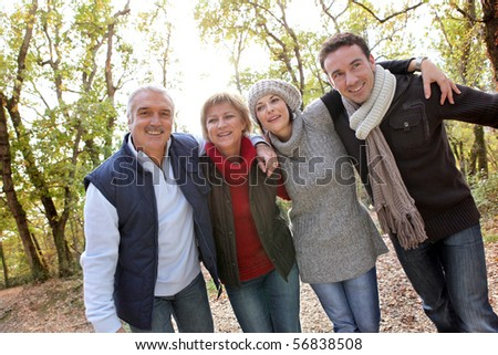 Portrait of smiling men and women in the countryside - stock photo