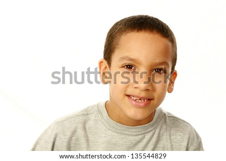 portrait of smiling mixed race boy isolated on white
