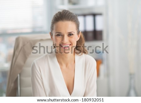 Portrait of smiling modern business woman in office - stock photo