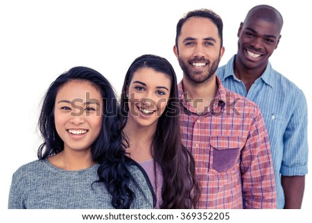 Portrait of smiling multi-ethnic friends standing in line against white background - stock photo
