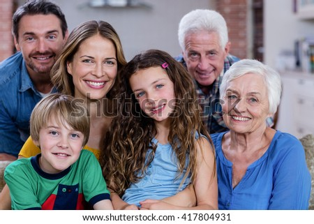 Portrait of smiling multi-generation family at home - stock photo
