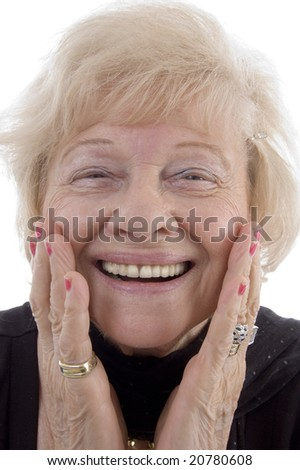 portrait of smiling old woman holding her face against white background - stock photo