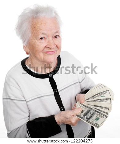 Portrait of smiling old woman holding money in hand on white background - stock photo