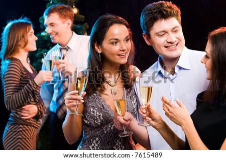 Portrait of smiling people interacting each other at a party - stock photo