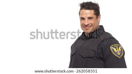 Portrait of smiling police man standing against white background - stock photo