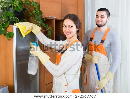 Portrait of smiling professional cleaners team in uniform at the work  - stock photo