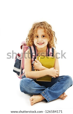 Portrait of smiling school girl with rucksack holding books. Isolated on white background - stock photo