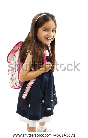 Portrait of smiling school girl with rucksack. Isolated on white background - stock photo