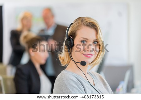 Portrait of smiling secretary in office - stock photo