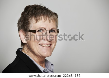 Portrait of smiling senior businesswoman, close up