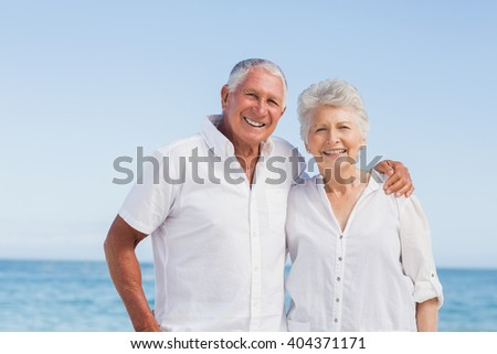Portrait of smiling senior couple on a sunny day - stock photo