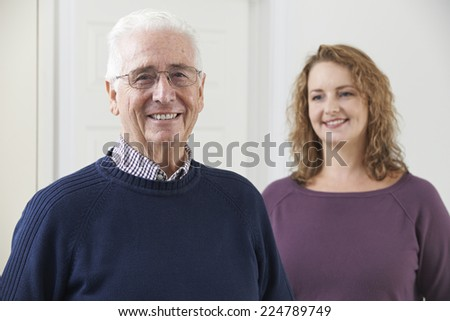 Portrait Of Smiling Senior Man With Adult Daughter - stock photo
