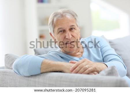 Portrait of smiling senior man with blue shirt - stock photo