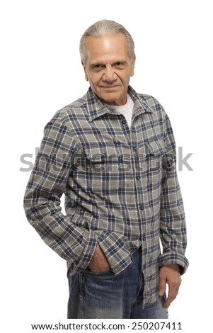 Portrait of smiling senior man with hand in pocket