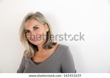 Portrait of smiling senior woman - stock photo