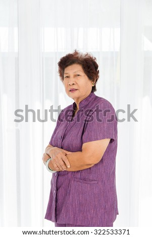 Portrait of smiling senior woman at home. - stock photo