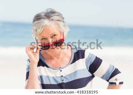 Portrait of smiling senior woman on a sunny day