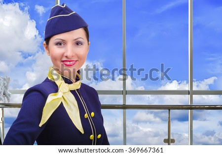 Portrait of smiling stewardess at the airport - stock photo