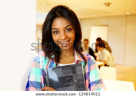 Portrait of smiling student girl - stock photo