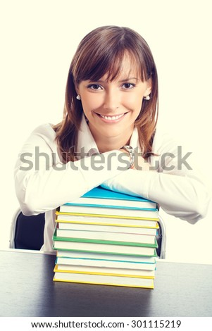 Portrait of smiling student or businesswoman with textbooks - stock photo