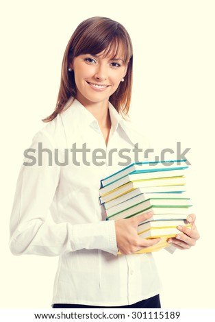 Portrait of smiling student or young businesswoman with textbooks - stock photo