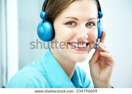 Portrait of smiling support phone operator in headset. customer service center - stock photo